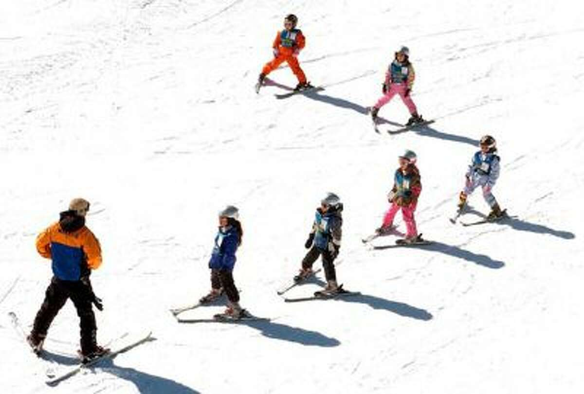 A ski instructor leads 4-6 year-olds in a group lesson at Mammoth Mountain in Mammoth Lakes, Feb. 28, 2005.