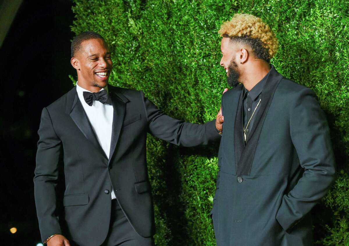 Victor Cruz, left, and Odell Beckham Jr. attend the 12th annual CFDA/Vogue Fashion Fund Awards on Monday at Spring Studios in New York.