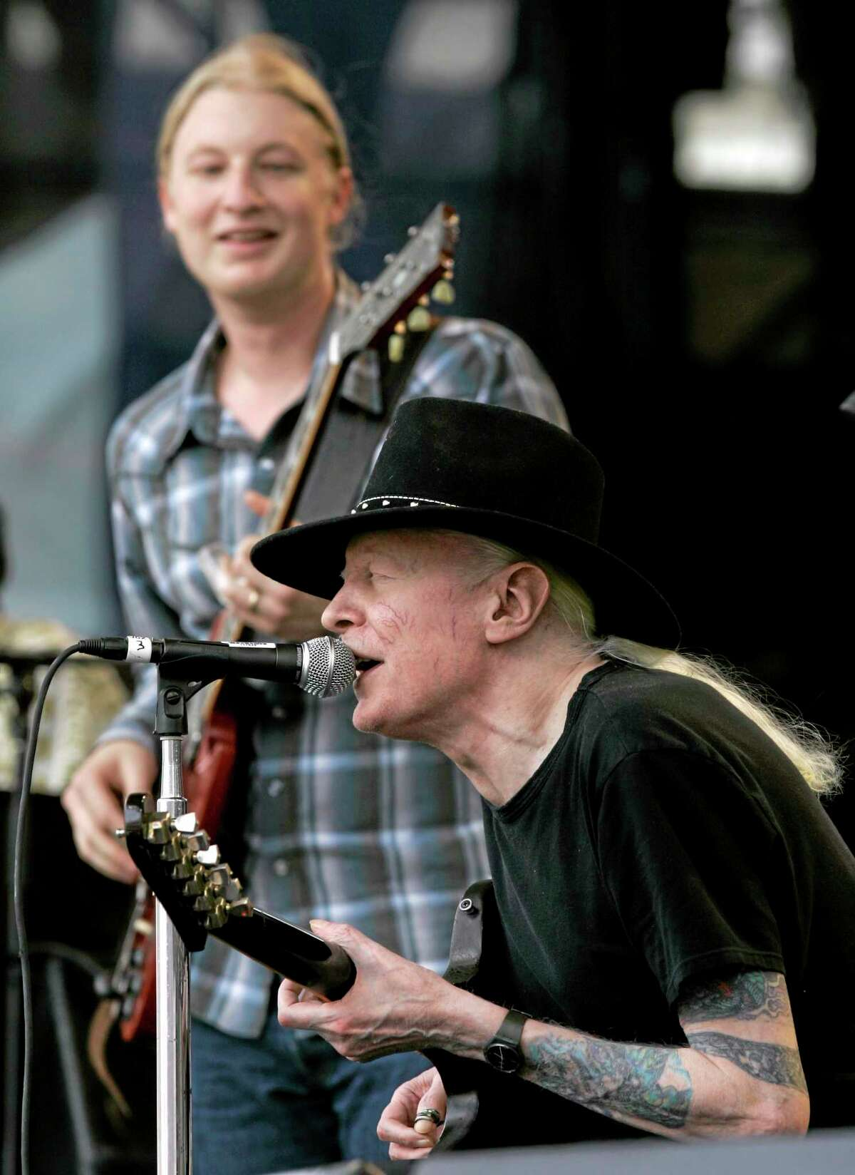 """FILE - In this Saturday, July 28, 2007 file photo, Johnny Winter, seated, and Derek Trucks, background, perform """"Highway 61"""" at the Crossroads Guitar Festival in Chicago. Texas blues icon Johnny Winter, who rose to fame in the late 1960s and '70s with his energetic performances and recordings that included producing his childhood hero Muddy Waters, died in Zurich, Switzerland on Wednesday, July 16, 2014. He was 70. (AP Photo/Charles Rex Arbogast, File)"""