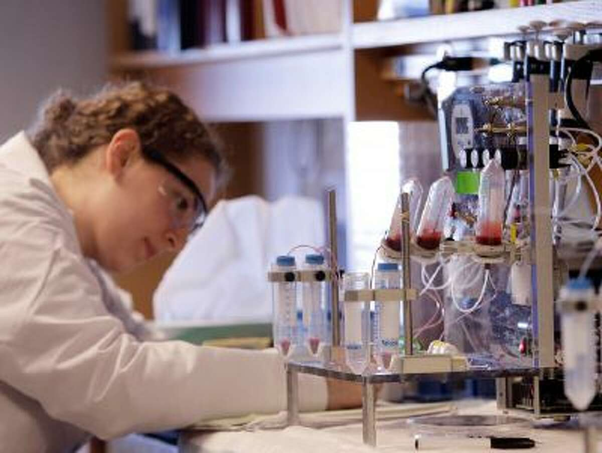 A researcher works near a blood test machine in Boston.