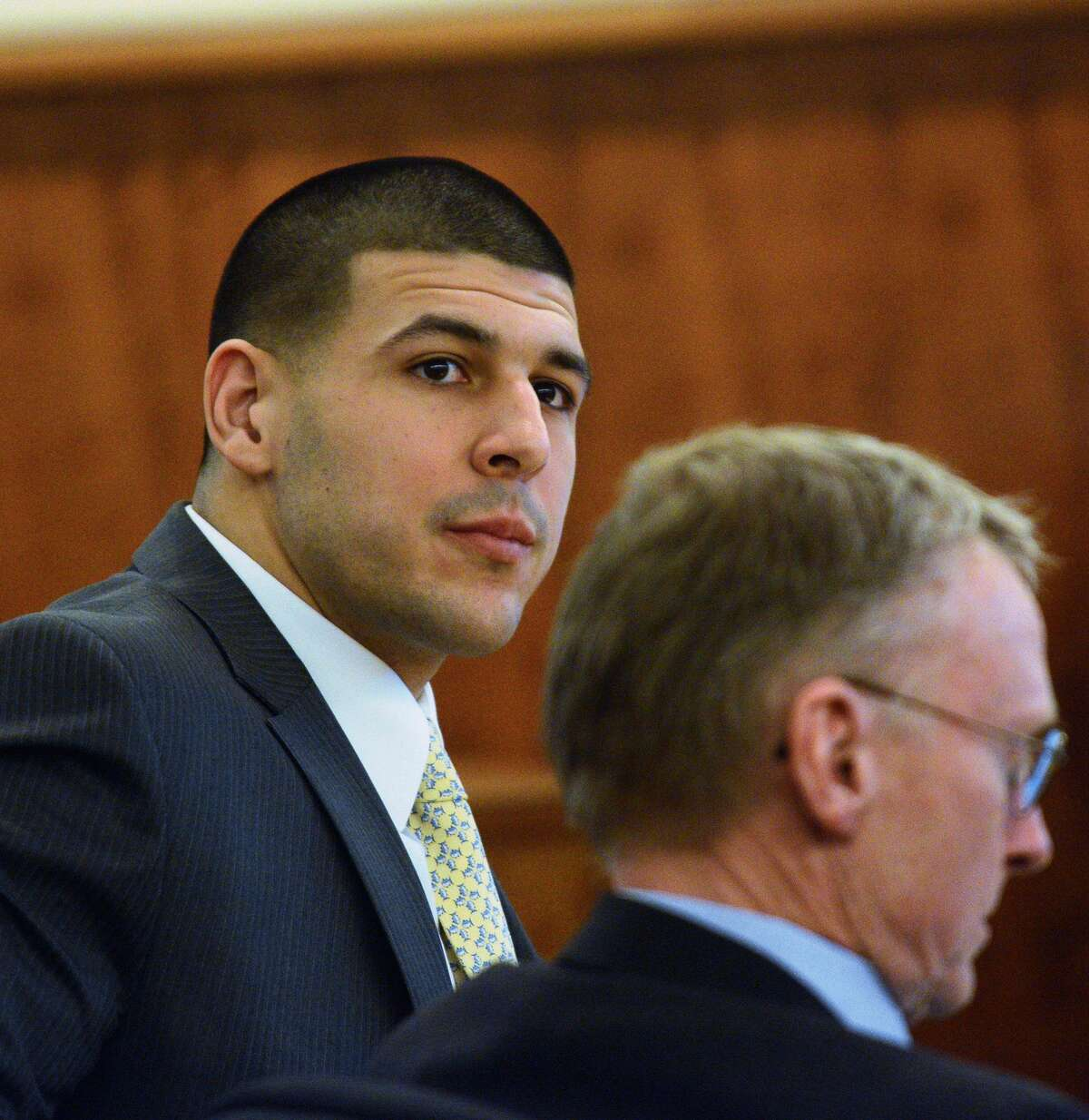 Former New England Patriots football player Aaron Hernandez, left, sits with his defense attorney Charles Rankin, right, during Hernandez's murder trial, Friday, March 6, 2015, in Fall River, Mass. Hernandez is charged with killing semiprofessional football player Odin Lloyd.