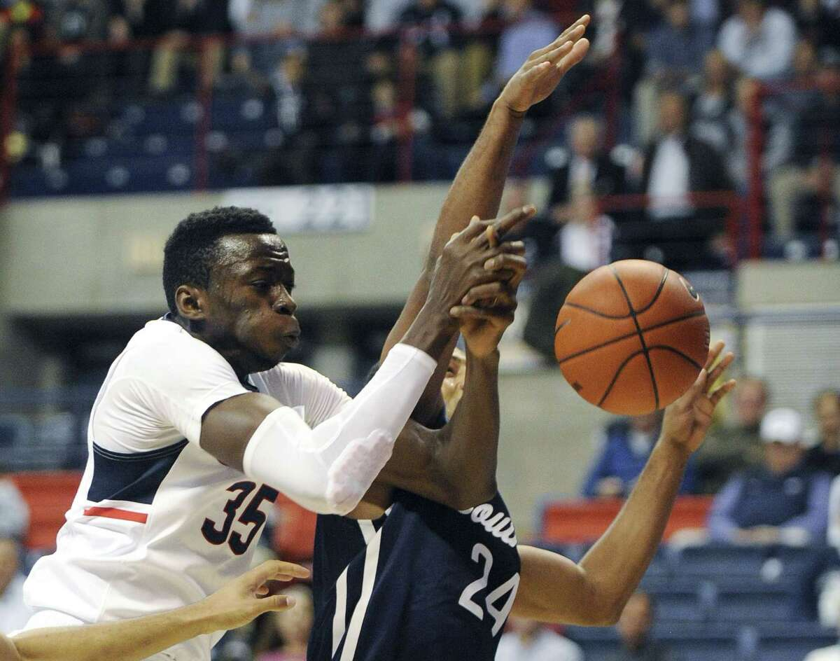 UConn's Amida Brimah, left, scrambles for a rebound with Southern Connecticut State's Deshawn Murphy during Tuesday night's exhibition game in Storrs.