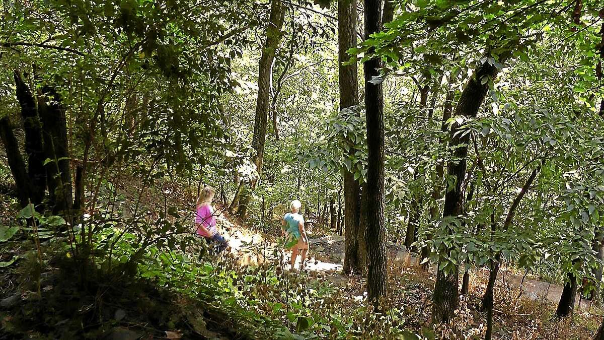 In this Aug. 1, 2012 photo, two women walk from the town of Harpers Ferry, W.Va., onto the Appalachian Trail.