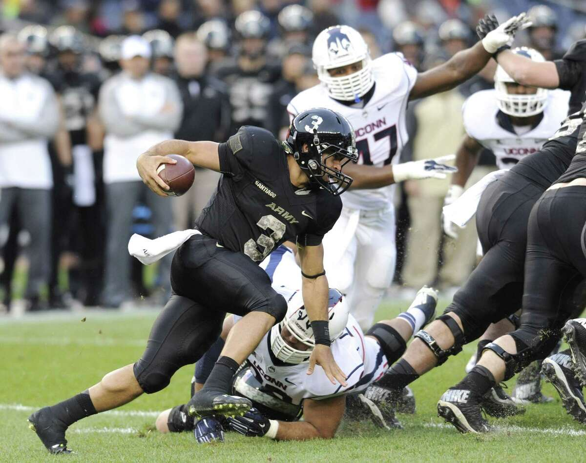 Army quarterback Angel Santiago runs with the ball during the Black Knights' 35-21 win over UConn on Saturday at Yankee Stadium in New York.