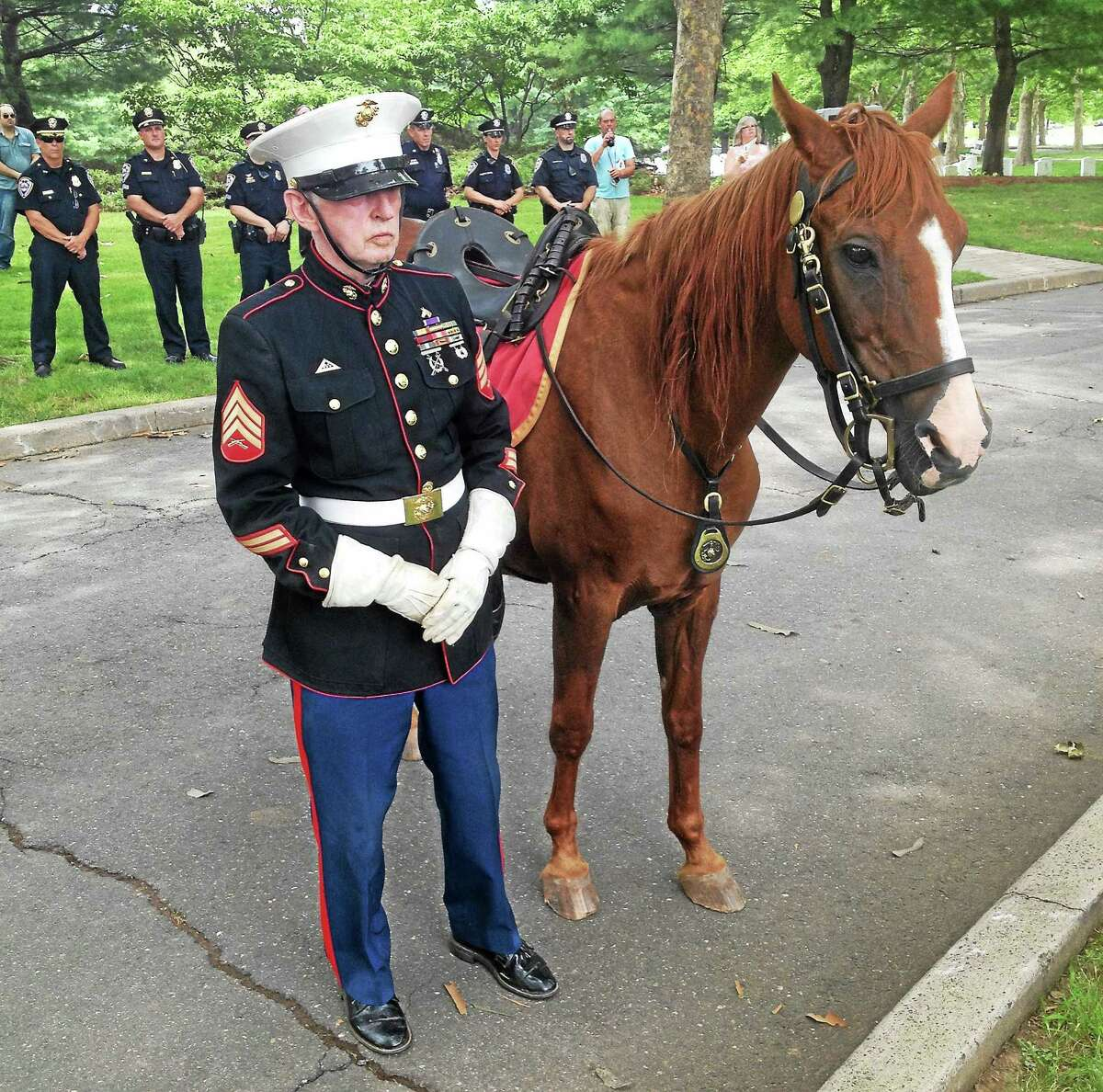 """""""While we may not have met them in life, we are laying them to rest with the greatest respect,"""" Lt. Gov. Nancy Wyman said during a burial ceremony Wednesday at the state cemetery on Bow Lane as hundreds took part and stood by."""