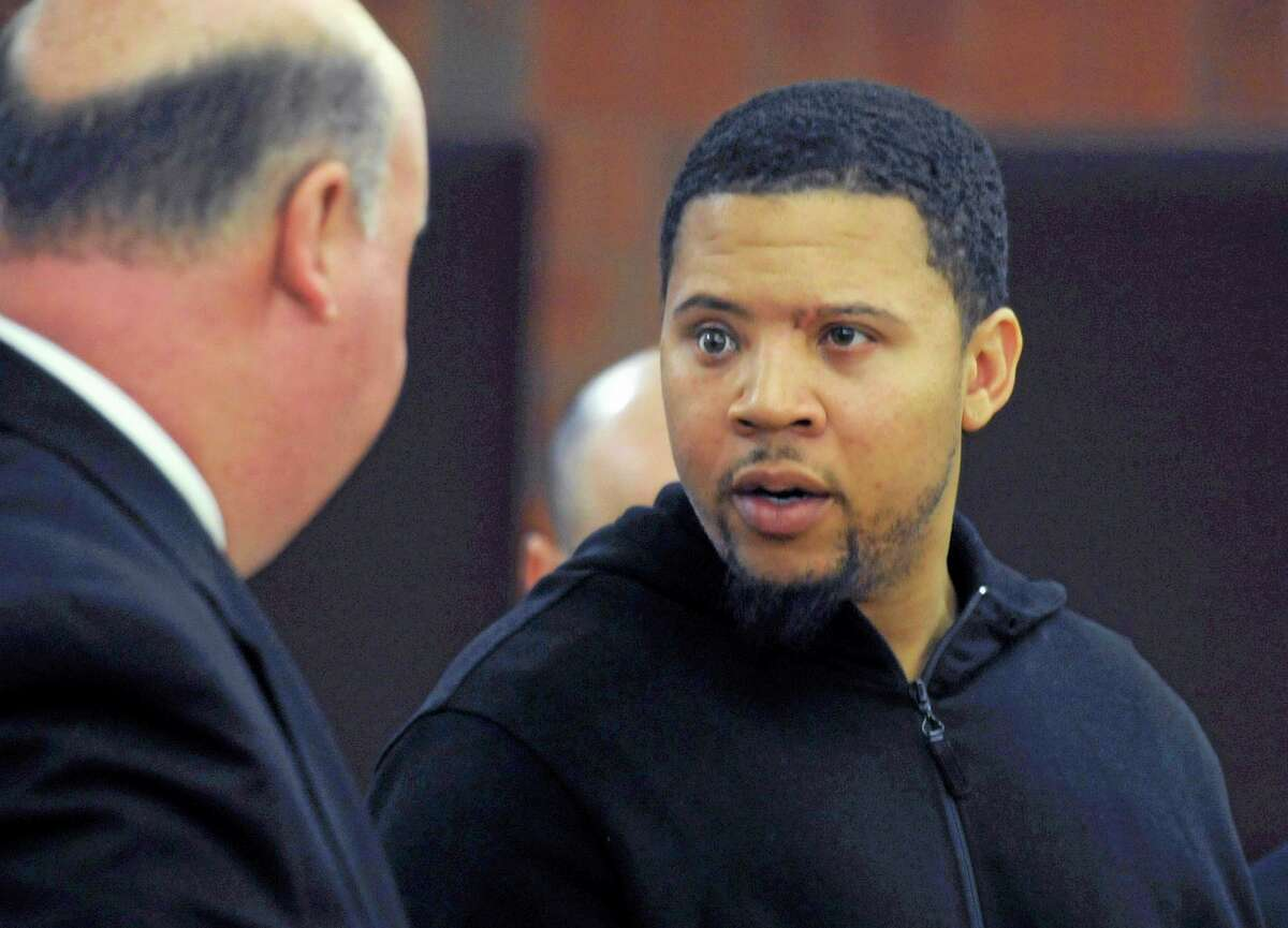 In this Friday, Oct. 4, 2013, file photo, Alexander Bradley, right, talks with his attorney Robert Pickering, left, during a court appearance at Hartford Superior Court on in Hartford, Conn. Bradley, who alleges he was shot by former New England Patriots tight end Aaron Hernandez, has been shot again in Connecticut. Hartford police Lt. Brian Foley says Bradley was shot several times in the leg Sunday night, Feb. 2, 2014, at the Vevo Lounge Bar & Grill, and was taken to a hospital. His condition hasn't been released.