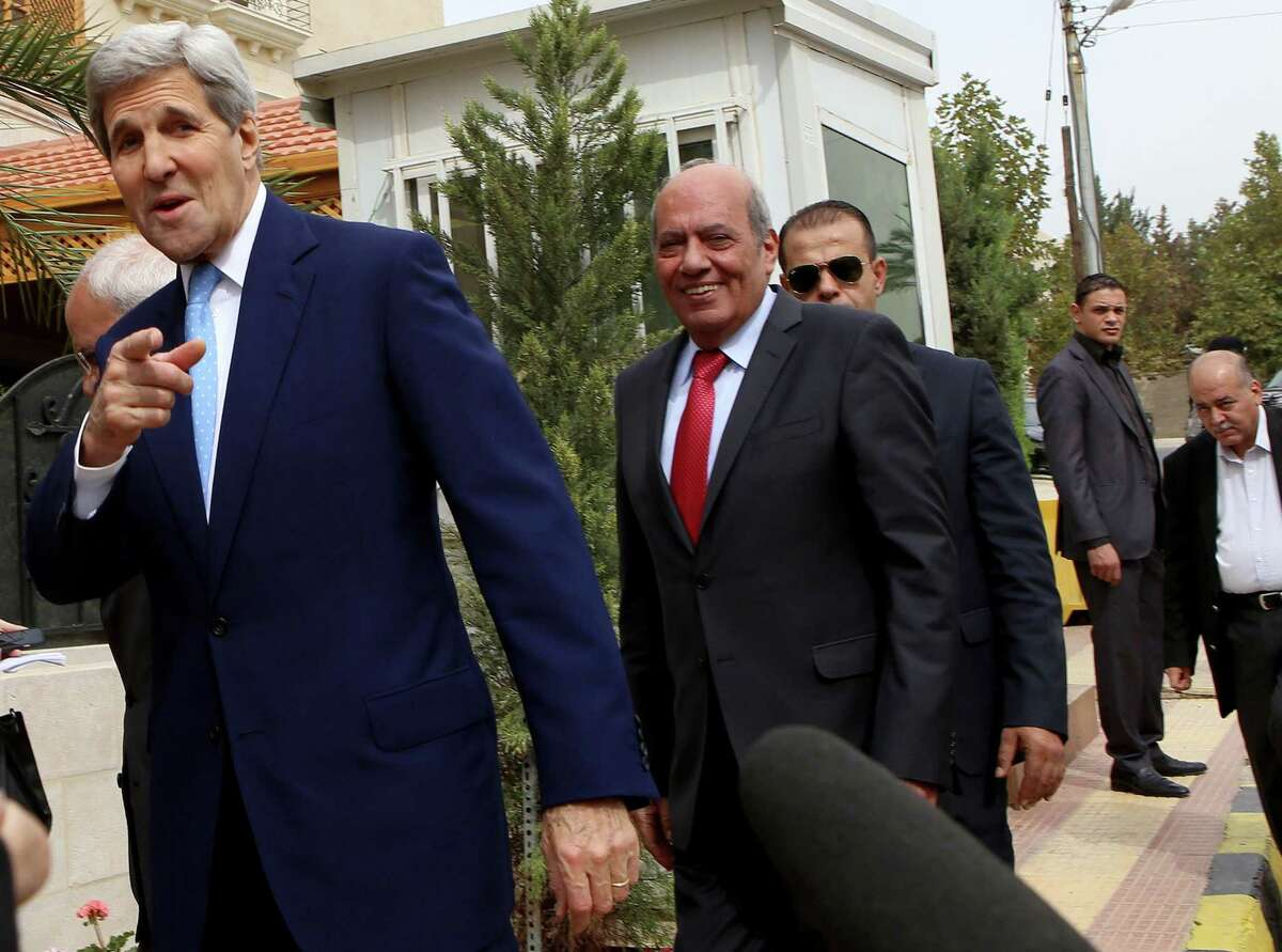 U.S. Secretary of State John Kerry, left, arrives for a meeting with Palestinian President Mahmoud Abbas at Abbas' residence, in Amman, Jordan, Saturday, Oct. 24, 2015. Kerry said Saturday that Israel and Jordan have agreed on steps aimed at reducing tensions at a holy site in Jerusalem that have fanned Israeli-Palestinian violence.