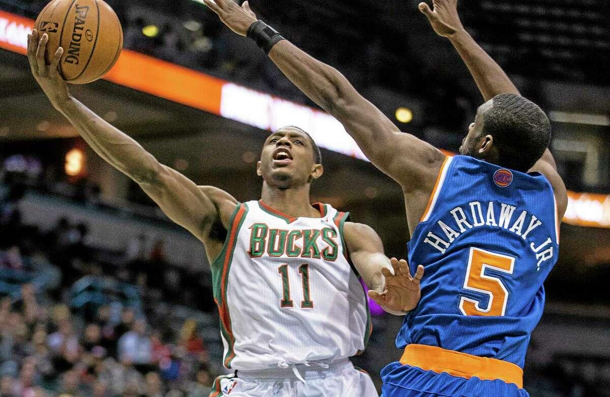 Milwaukee Bucks' Brandon Knight drives past New York Knicks' Tim Hardaway Jr. during the second half of an NBA basketball game, Monday, Feb. 3, 2014, in Milwaukee. The Bucks defeated the Knicks 101-98. (AP Photo/Tom Lynn)
