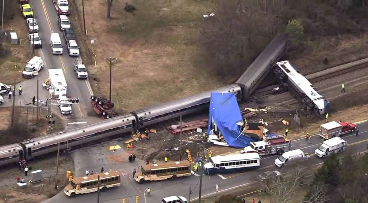 In this frame grab from video provided by WTVD-11, authorities respond to a collision between an Amtrak passenger train and a truck, Monday, March 9, 2015, in Halifax County, N.C. According to Halifax County Sheriff Wes Tripp, none of the injuries appeared to be life-threatening.