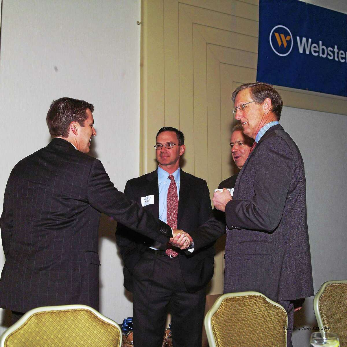 Rece Davis of ESPN, Webster Bank Vice President James Lane, Webster Bank Executive Vice President of Commercial Real Estate Bill Wrang and Webster Financial Corp. President Joe Savage at the Chamber's Member Breakfast on Jan. 27.