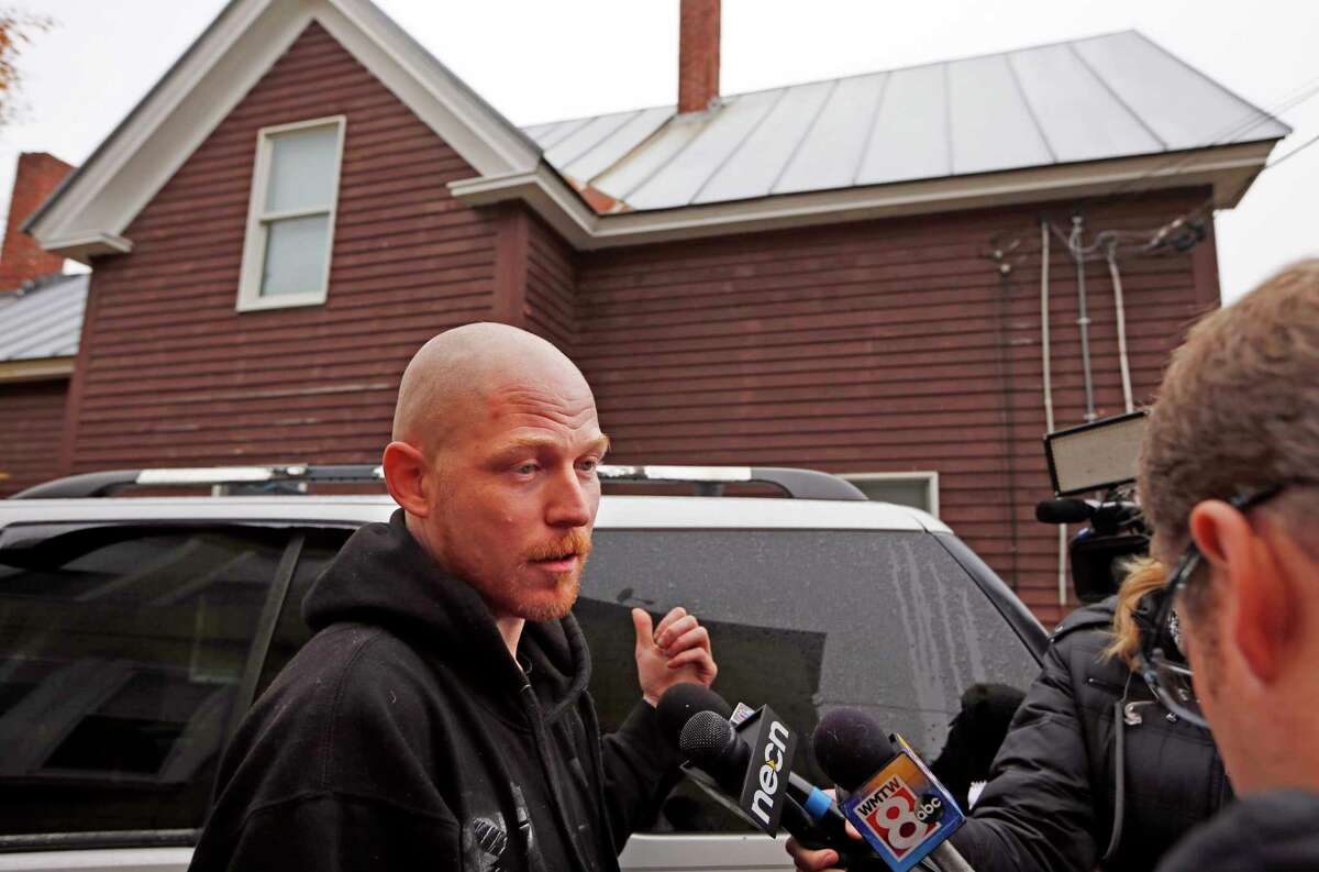 Jason Thomas speaks to reporters outside his home, Thursday, Nov. 5, 2015, next door to a home where two women and a man were shot to death in Oakland, Maine. Police say the gunman shot himself outside the residence and was found in the driveway. Thomas said he spoke by cell phone to one of the victims after she was shot but did not know what sparked the violence.