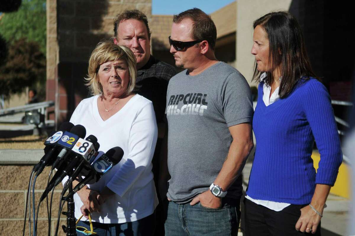 """Joseph McStay's mother Susan McStay, left, brother Michael McStay, center, Michael's wife Erin , right, and family friend Gerrit Macey, talk with the media, Friday, Nov. 7, 2014, after seeing Charles """"Chase"""" Merritt appear for a hearing at the Victorville Courthouse in Victorville, Calif. Merritt, 57, made a brief court appearance Friday on four counts of murder in the February 2010 deaths of Joseph McStay, 40, his wife, Summer, 43, and their sons, 4-year-old Gianni and 3-year-old Joseph. The family's remains were found last year buried in the desert. He did not enter a plea and was due back in court next week. (AP Photo/The Victor Valley Daily Press, David Pardo)"""