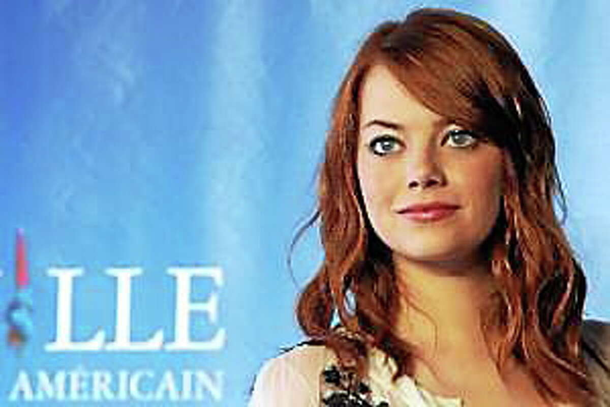 """Emma Stone poses during the photocall of the movie """"The Help"""" at the 37th American Film Festival, in Deauville, northwestern France, on Sept. 3, 2011."""