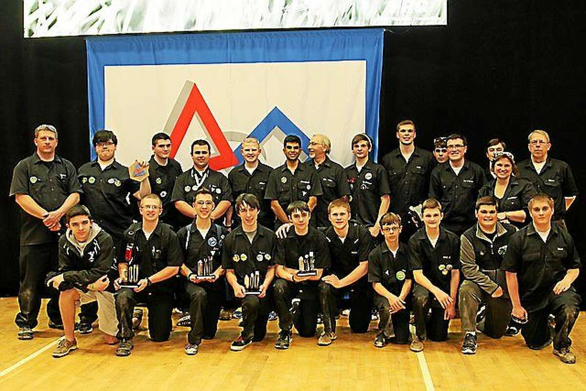 Members of Xavier High School's FullMetal Falcons, the school's FIRST Robotics Team No. 4557.