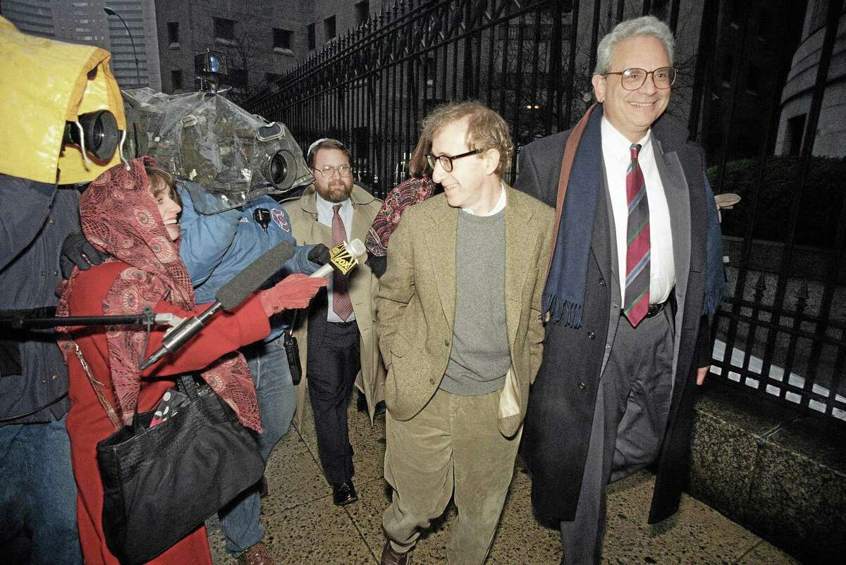 This Jan. 12, 1993 file photo shows director Woody Allen trading grins with a pursuing television reporter as he arrives at State Supreme Court in Manhattan, New York, for a hearing in which he requested more liberal visitation rights with his children during his ongoing dispute with ex-lover actress Mia Farrow. AP Photo/Mario Cabrera