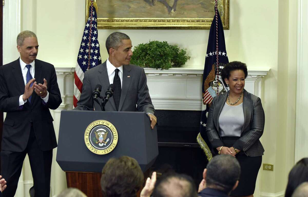 President Barack Obama announces he will nominate U.S. Attorney Loretta Lynch, right, to be the next Attorney General, Saturday, Nov. 8, 2014, in the Roosevelt Room of the White House in Washington. Lynch would succeed Attorney General Eric Holder, left. (AP Photo/Susan Walsh)