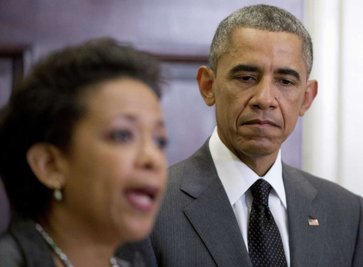 President Barack Obama listens as US Attorney Loretta Lynch speaks, in the Roosevelt Room of the White House in Washington, Saturday, Nov. 8, 2014, where the president announced that he will nominate Lynch to replace Attorney General Eric Holder. (AP Photo/Carolyn Kaster)