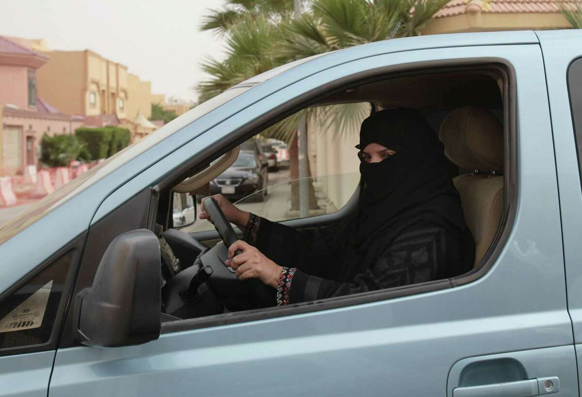 FILE - In this file photo taken Saturday, March 29, 2014, Aziza Yousef drives a car in Riyadh, Saudi Arabia, as part of a campaign to defy Saudi Arabia's ban on women driving. A Saudi official said Friday, Nov. 7, that the kingdom's advisory council has recommended to the government for the first time the partial lifting of the ban on women driving, but with conditions: Only women over 30, only during the day, and no makeup allowed while driving. (AP Photo/Hasan Jamali, File)
