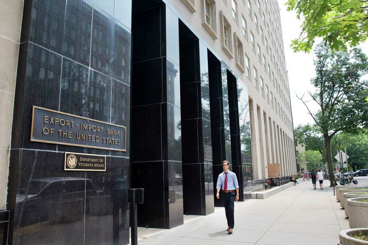 In this photo taken July 28, a man walks past the Export-Import Bank of the United States, in Washington.