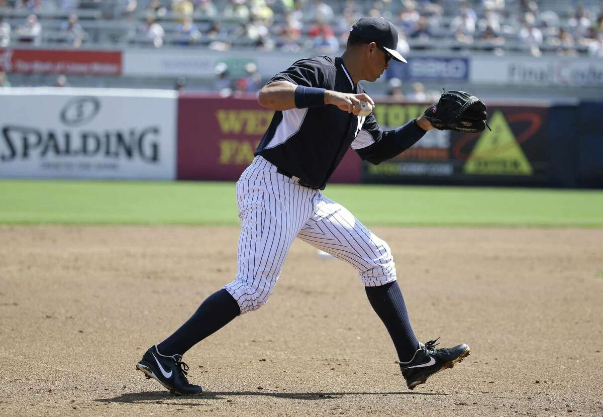 Yankees third baseman Alex Rodriguez throws to pitcher Adam Warren in the second inning Sunday.