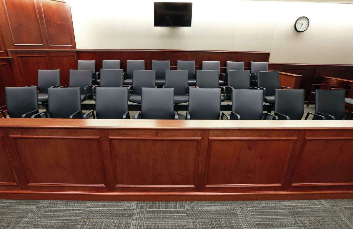 FILE - In this Jan. 15, 2015 file photo, a view of the jury box inside Courtroom 201, where closing arguments in the trial of Aurora movie theater shootings defendant James Holmes are to take place on July 14, 2015, at the Arapahoe County District Court in Centennial, Colo. Jurors in the Colorado theater shooting trial soon will retreat into the largest jury room in the courthouse to determine whether Holmes was legally insane at the time of the killing spree. (AP Photo/Brennan Linsley, pool, file)