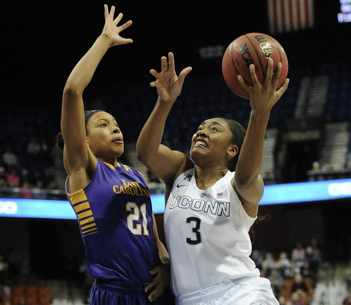 UConn's Morgan Tuck, right, shoots as East Carolina's Abria Trice defends.