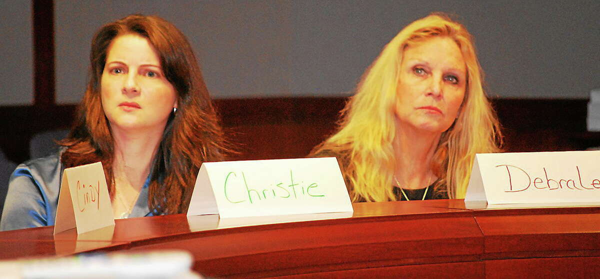 State Rep. Christie Carpino, left, with state Rep. DebraLee listen to a lecture during a two-day Mental Health First Aid training class.