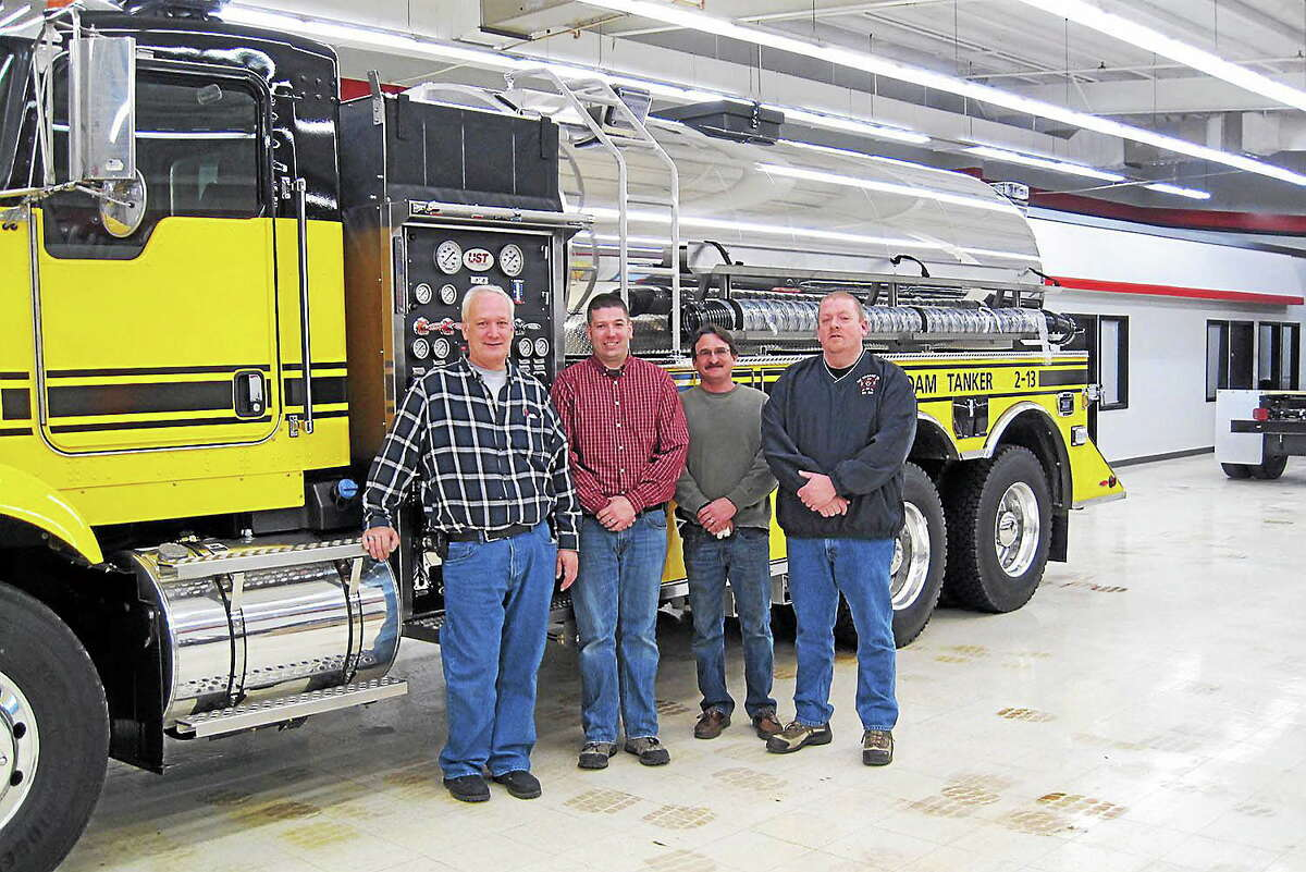 On Jan. 13, four 2-13 committee members conducted an on-site inspection of the new tanker at U.S. Tanker in Delavan, Wisc. From left, John Boothroyd, Apparatus Engineer Franklin Pierce, 1st Assistant Chief Gene Melanson and Fire Department President Scott Larson. The new 2-13 is expected to go into service sometime in February.