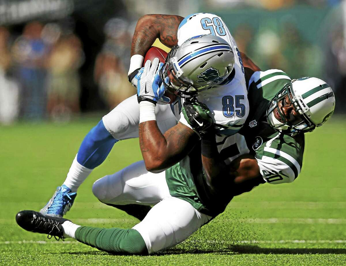 Detroit Lions tight end Eric Ebron is tackled by New York Jets cornerback Darrin Walls during a Sept. 28 game in East Rutherford, N.J.