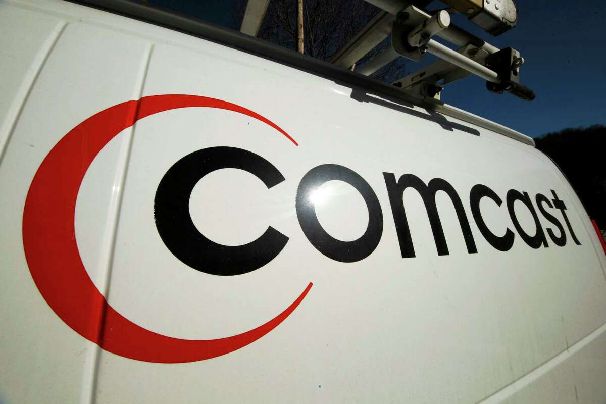 FILE - This Feb. 11, 2011 file photo shows the Comcast logo on one of the company's vehicles, in Pittsburgh.