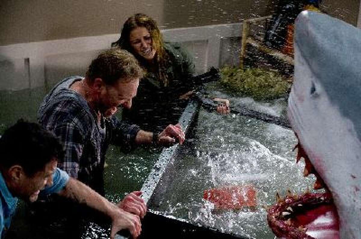 "Ian Ziering as Fin and Cassie Scerbo as Nova in ""Sharknado."""