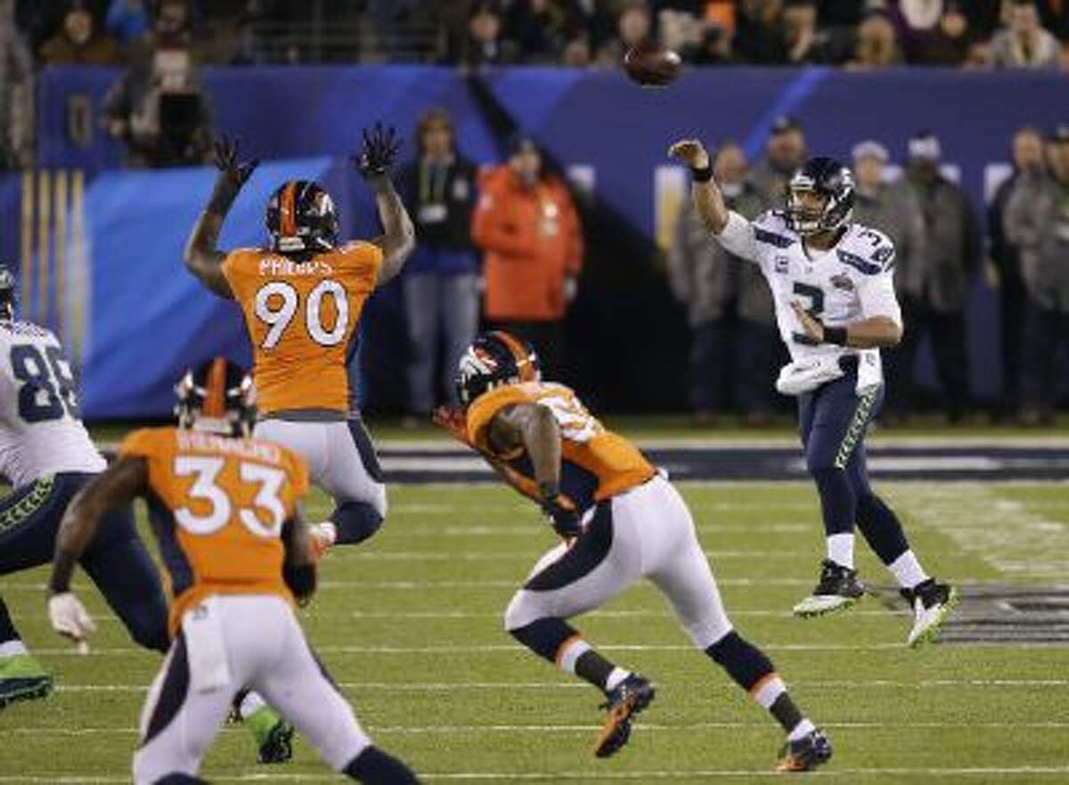 Shaun Phillips (90) can't defend a pass from Russell Wilson in the Super Bowl.