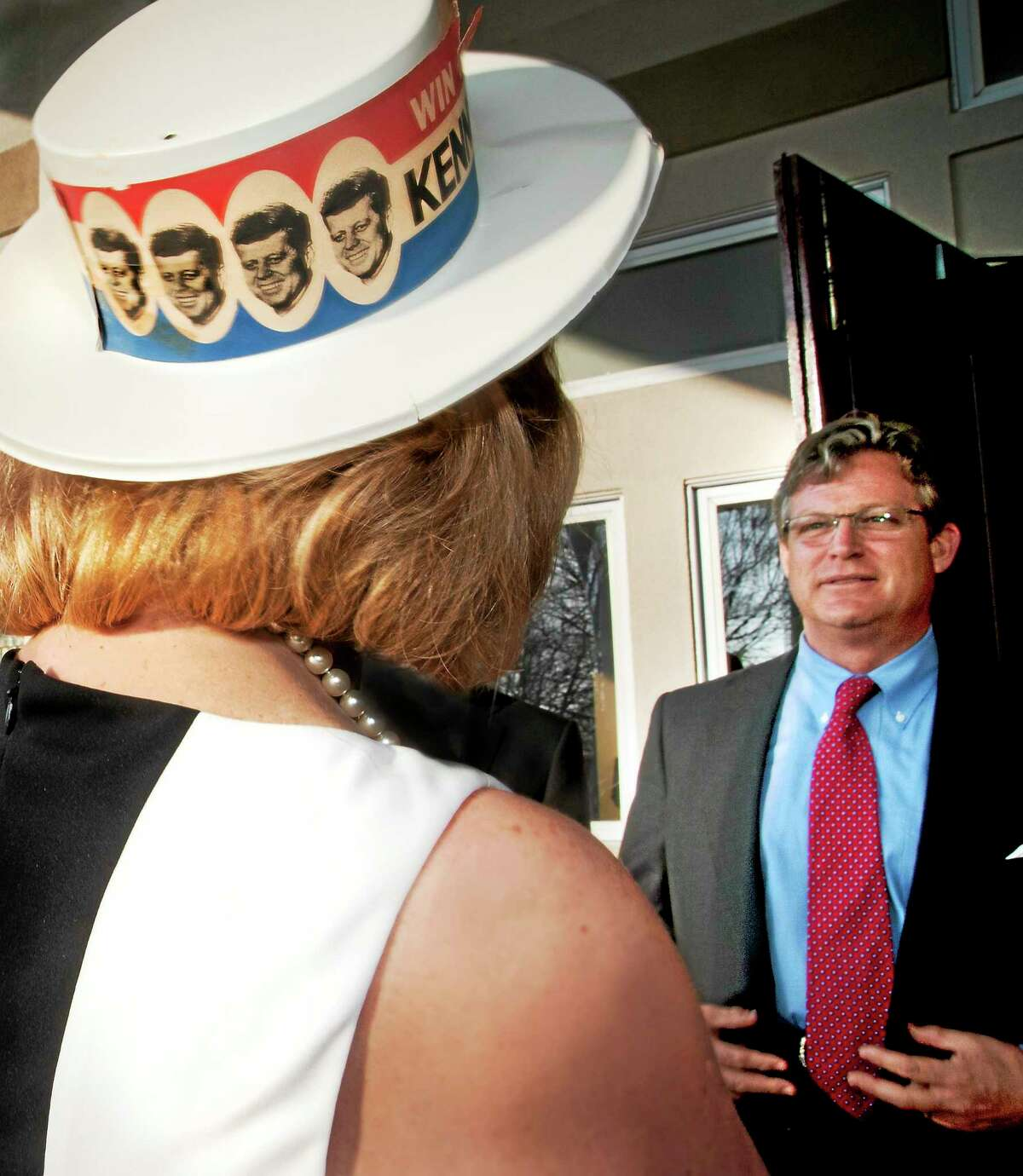 (Melanie Stengel - Register) ¬ Bonnie Fitch, of Nortford wears a vintage Kennedy campaign hat as she is greeted by Ted Kennedy Jr. at the annual SARAH gala at Woodwinds in Branford 5/1.