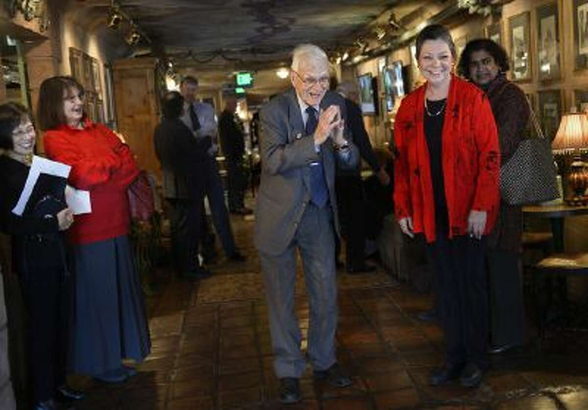 Lennox Tierney bows as he greets the KOTO musicians, Hatumi Bryant and Kimiko Osterloh as he enters his 100th birthday party. Cathy Edens, right, a former student of his, organized the party. Tierney, now 100 years old, was part of the effort to preserve Japanse art during Douglas McArthur's occupation in WWII. Friends and family held a birthday party for him at LaCaille, Sunday, Jan. 26, 2014.