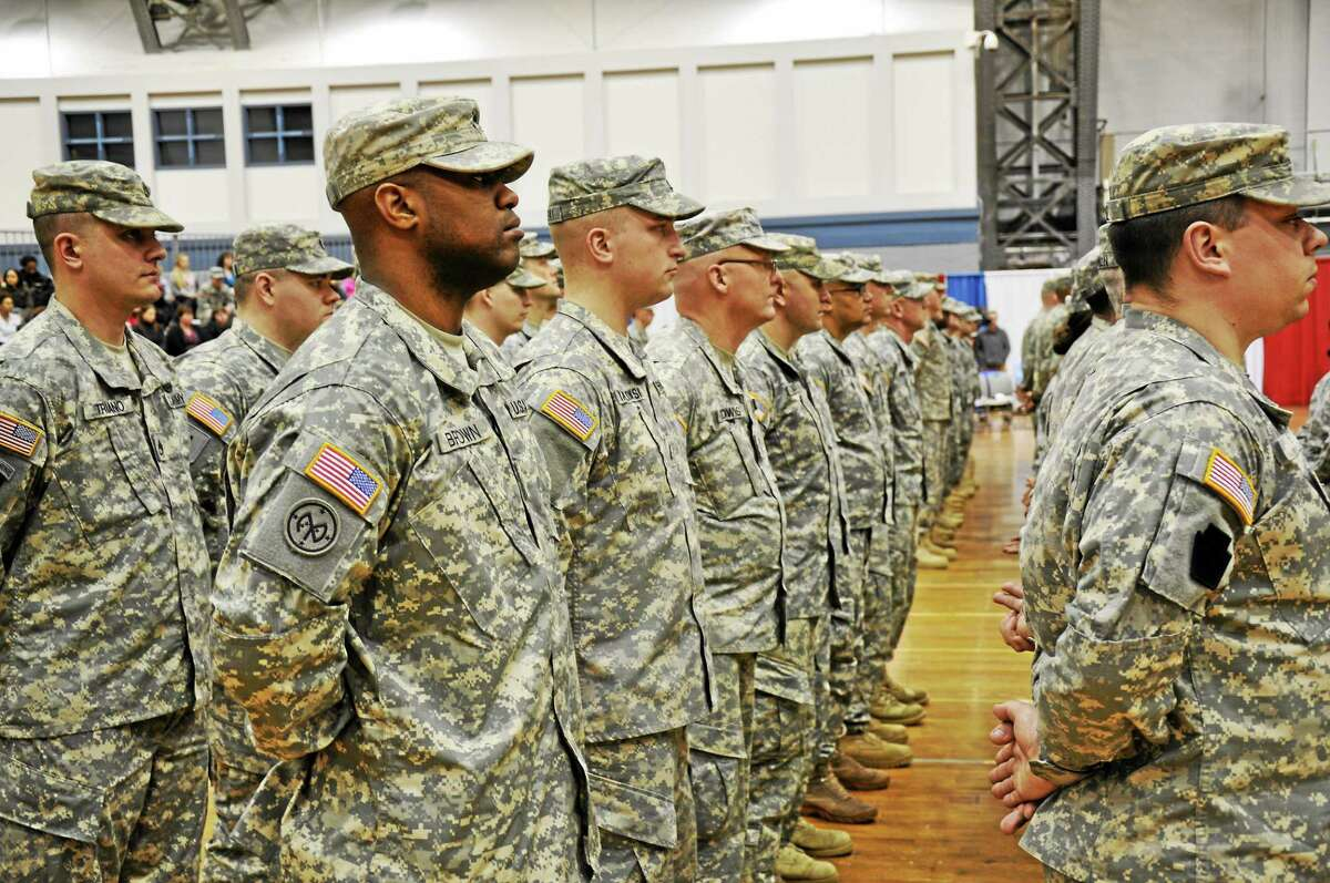 Soldiers of the 143rd Regional Support Group and the 192nd Military Police Battalion appear at a send-off ceremony on March 5 in Hartford.