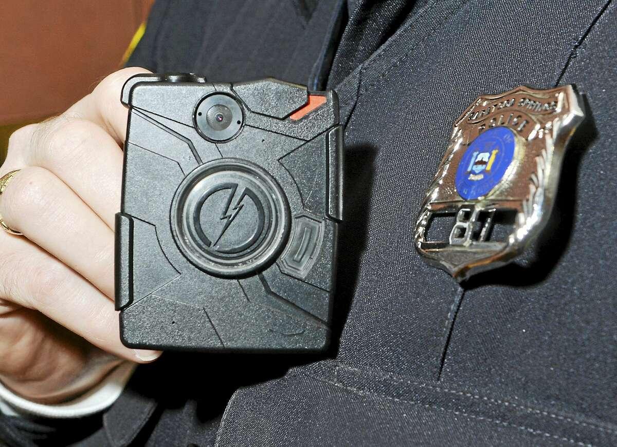 Saratoga Springs police officer Scott Johnson displays a body camera.