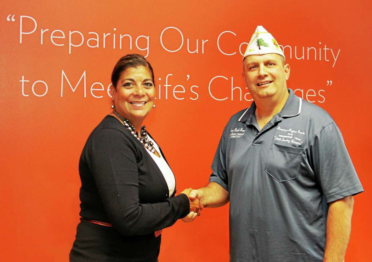 """Community Renewal Team's president and CEO, Lena Rodriguez, is joined by Harry """"Butch"""" Hansen, commander of the American Legion Department of Connecticut, who recently announced an affordable assisted living residence for Veterans as his """"Commander's Project"""" for the 2014-15 program year."""
