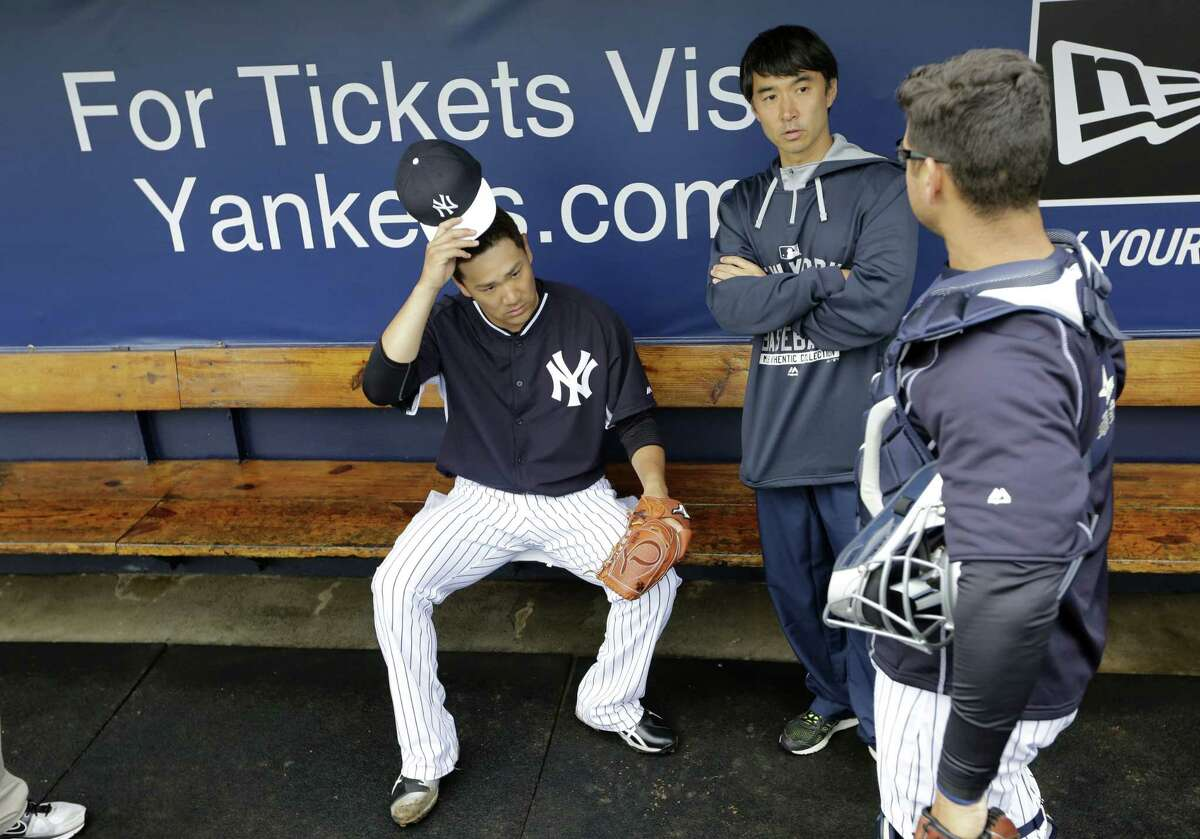 New York Yankees starter Masahiro Tanaka, left, sits in the dugout after throwing an inning in a simulated game Saturday in Tampa, Fla.