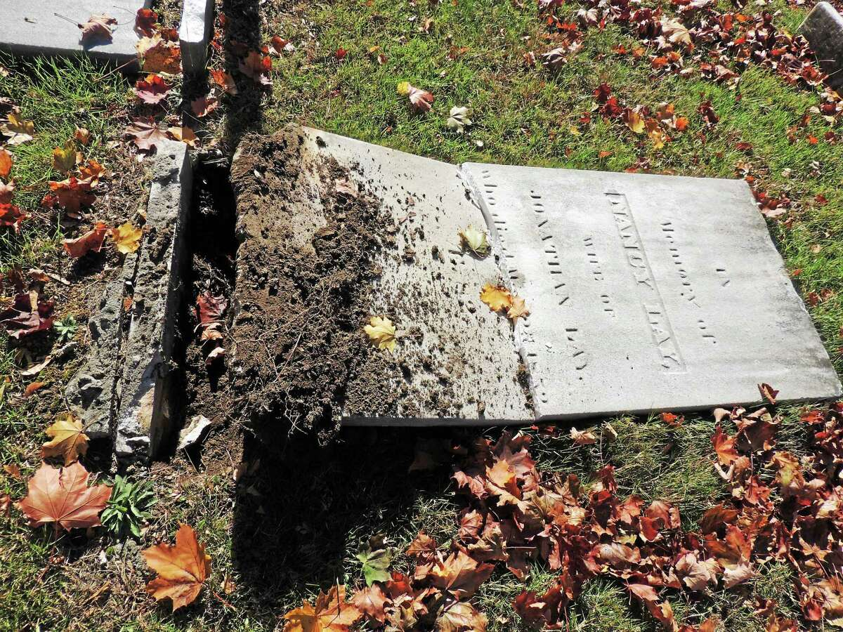Photo courtesy of Cathie Doane Dozens of headstones were knocked over, damaged and moved this past weekend at the Old Burying Ground Cemetery on Old Clinton Road in Westbrook. Among them was the headstone of prominent early resident Nancy Lay, who died in May 1852 at 82.
