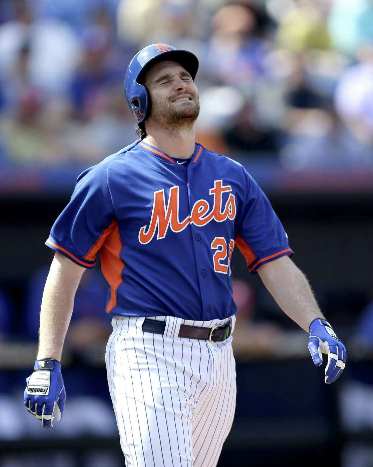 New York Mets second baseman Daniel Murphy grimaces after being hit by a pitch Friday by the Detroit Tigers' David Price in Port St. Lucie, Fla.