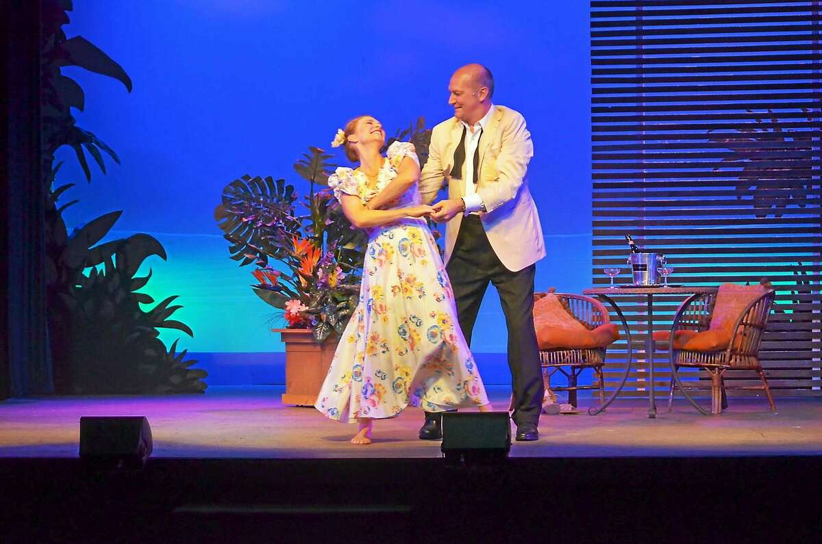 """Nellie and Emile dance in the Ivoryton Playhouse production of """"South Pacific,"""" which plays through July 26."""