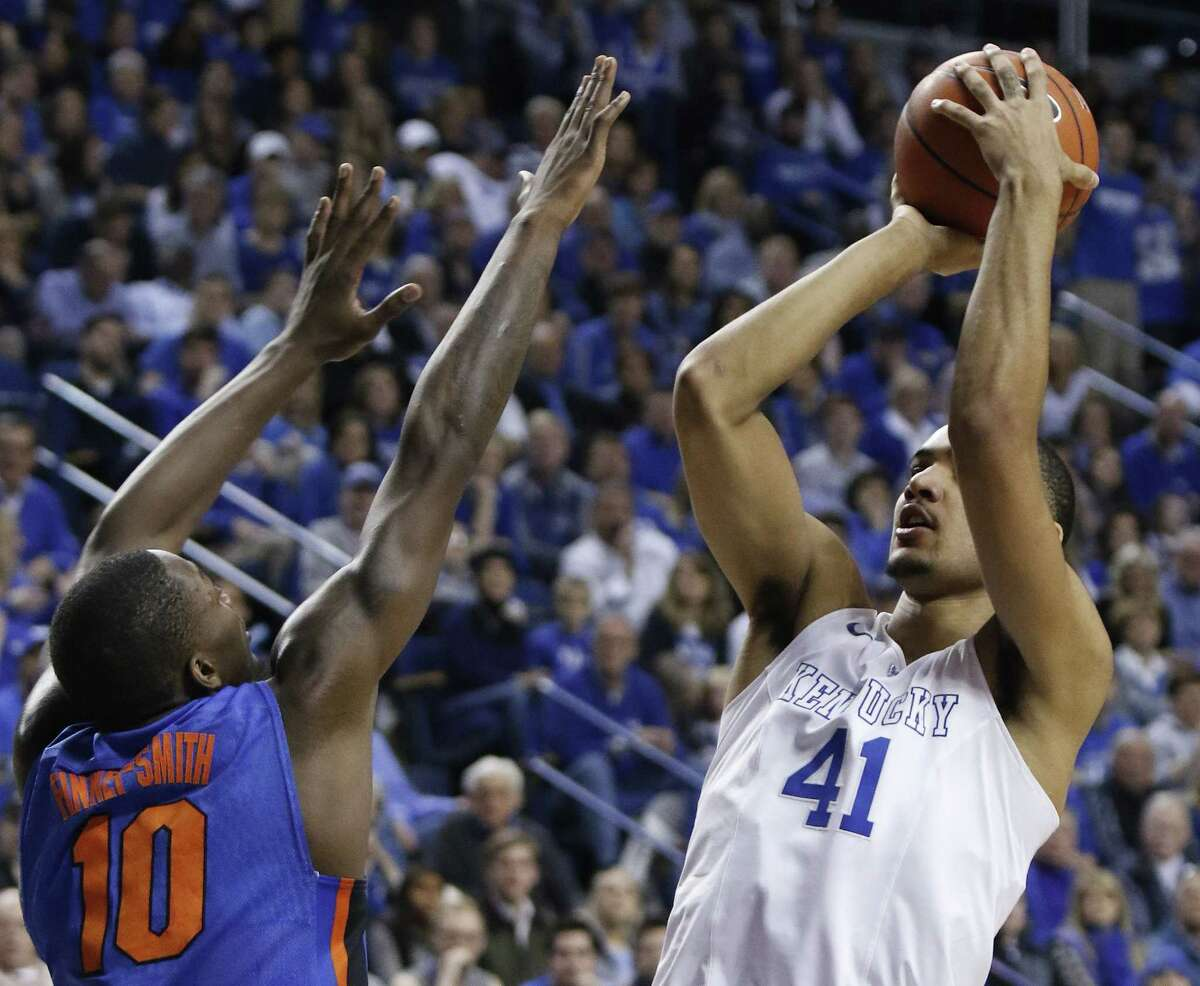 Kentucky's Trey Lyles shoots while being pressured by Florida's Dorian Finney-Smith during Saturday's game in Lexington, Ky.