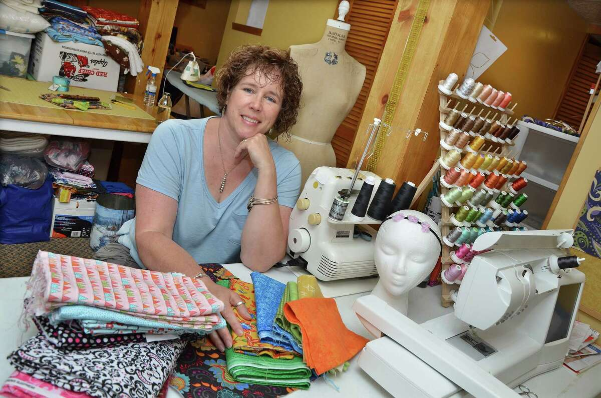 Kimberly Dragone Barcello in the sewing room at the Middletown home of Linda Allain Wednesday afternoon. Barcello is collecting fabric and quilting materials for a woman who is rebuilding her life following incarceration.
