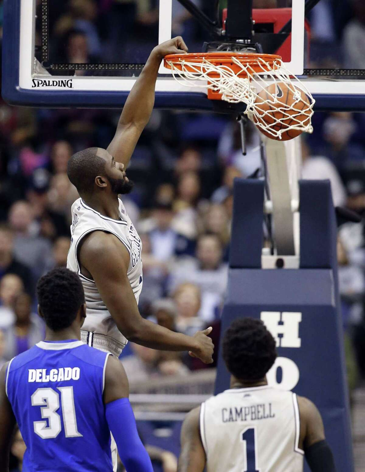Georgetown center Tyler Adams dunks the ball against Seton Hall on Saturday in Washington. Adams started, and hasn't played in a game since 2011, sidelined because of a heart ailment.