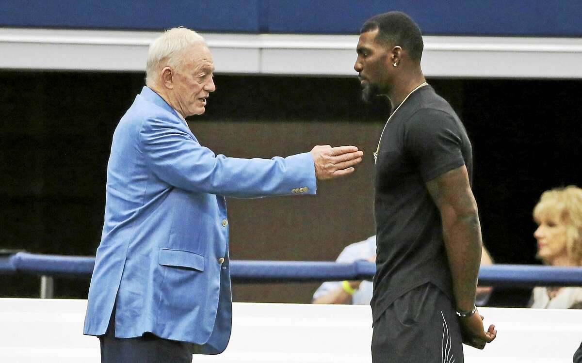 Dallas Cowboys wide receiver Dez Bryant, right, and team owner Jerry Jones talk on the sidelines during a minicamp at the team's stadium in June.