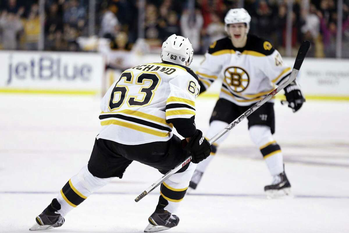 The Bruins' Brad Marchand celebrates his overtime goal with teammate Torey Krug Saturday against the Philadelphia Flyers in Boston.