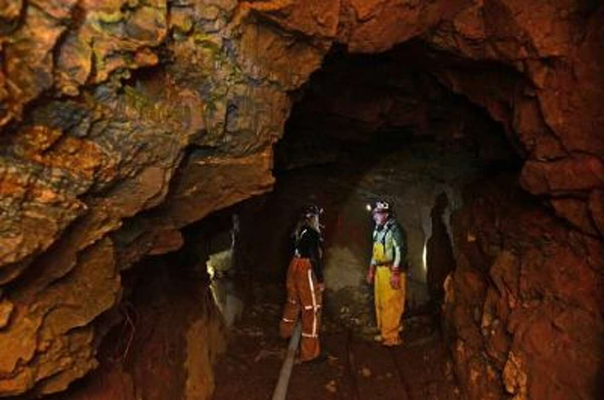 Miner Tom Hendricks, right, checks on areas inside his mine with miner Justin Short, left, inside the Cross Mine at Caribou in Nederland, Co.