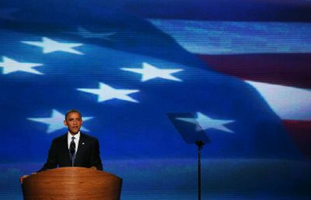 U.S. President Barack Obama speaks on stage as he accepts the nomination for president during the final day of the Democratic National Convention at Time Warner Cable Arena on September 6, 2012 in Charlotte, North Carolina.
