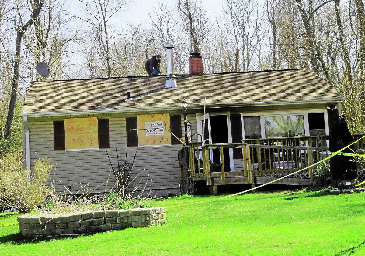 A firefighter was hit by a fire truck and a local couple were treated for burns after a blaze tore through a home on Edwards Road in Durham on April 23, 2014.