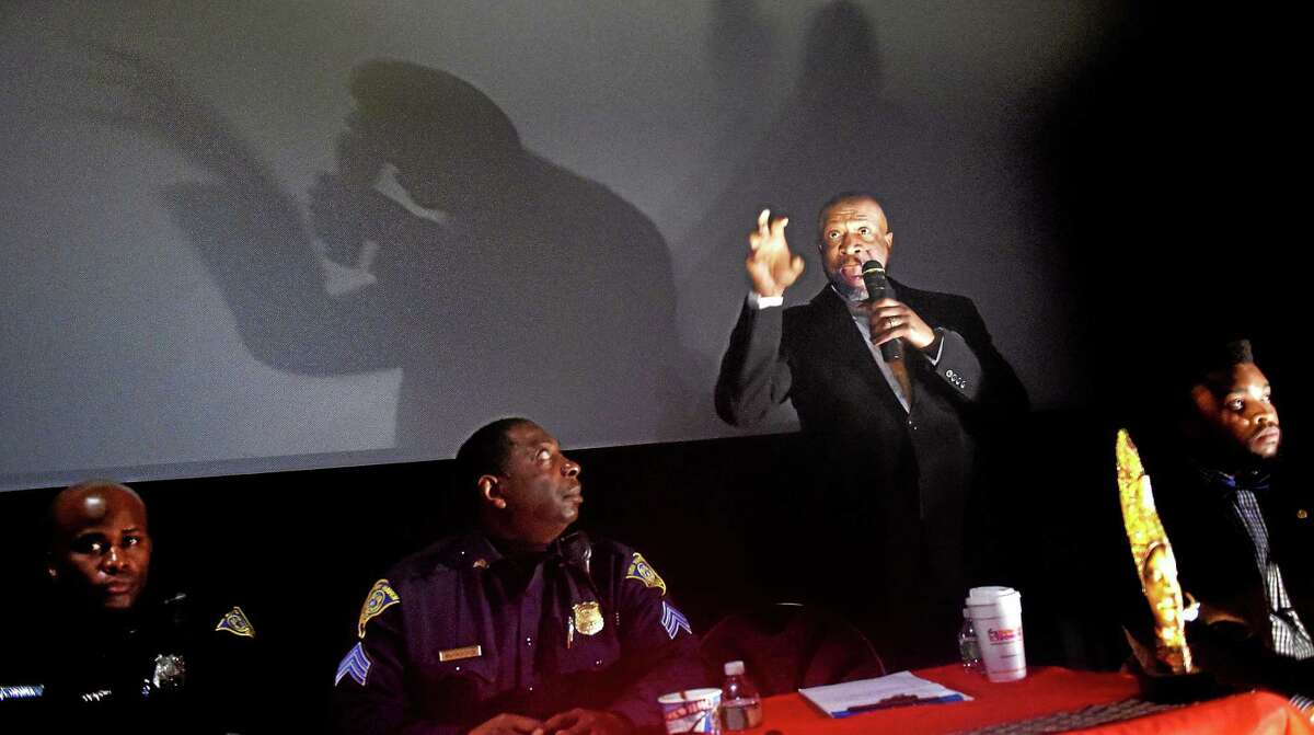 (Arnold Gold-New Haven Register) Pastor Anthony L. Bennett of Mount Aery Church in Bridgeport speaks at the community discussion, Voices of Our Black Men, before a screening of the movie, Selma, at the Criterion Cinemas in New Haven on 2/26/2015.